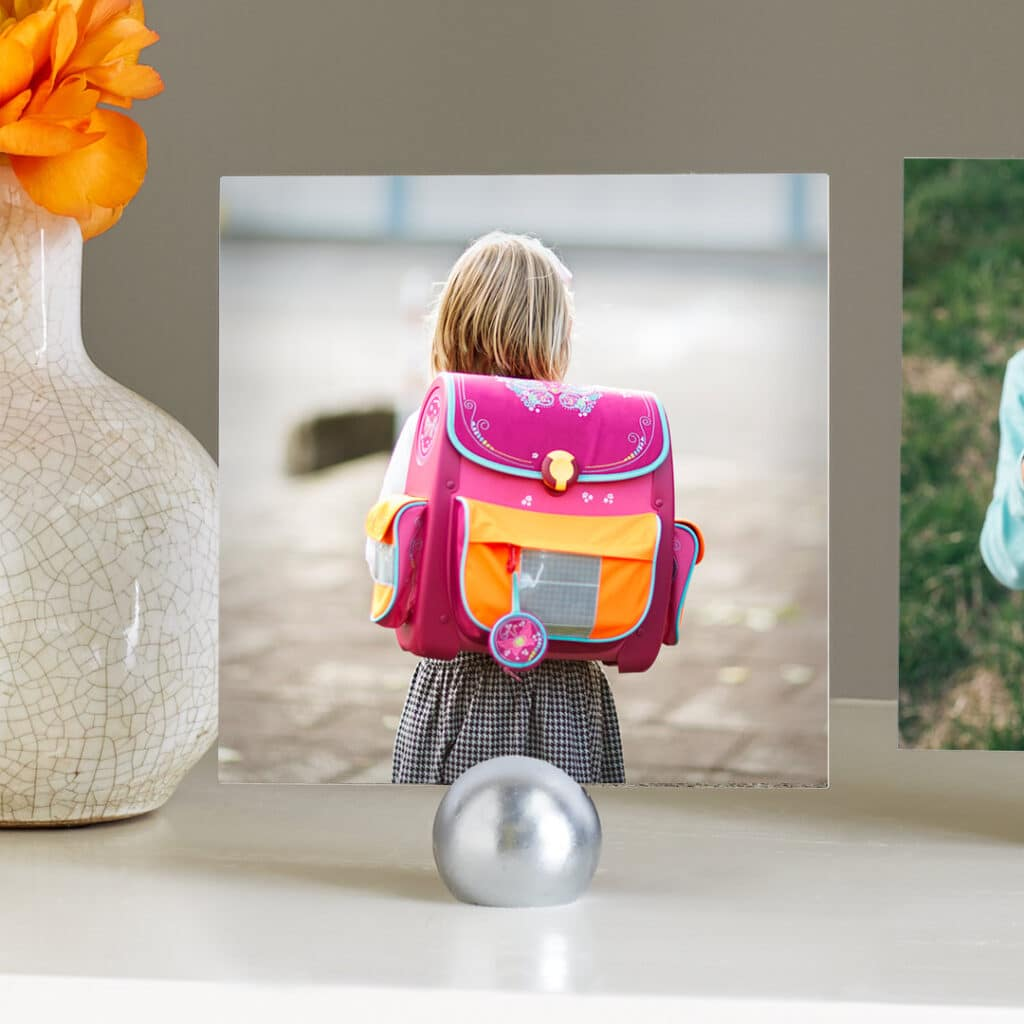 Create and share multiple prints of your child looking tiny and precious wearing their big new school bag.