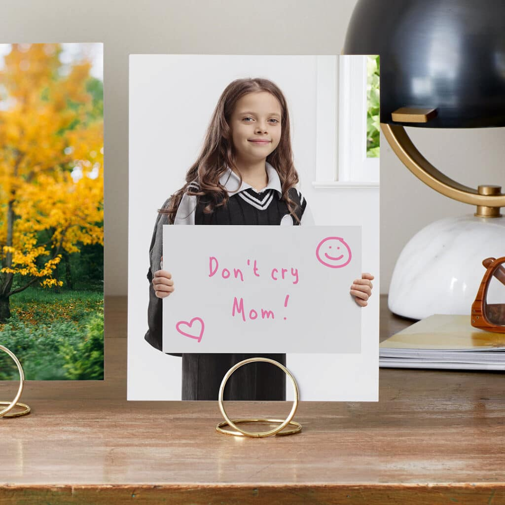 Capture and print a portrait of your child on the first day of school with a funny sign for Mom or Dad.
