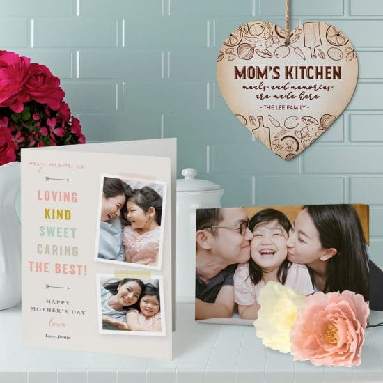 Mother's Day card and tabletop canvas print sitting on a kitchen counter with a stone heart trivet hanging in the background