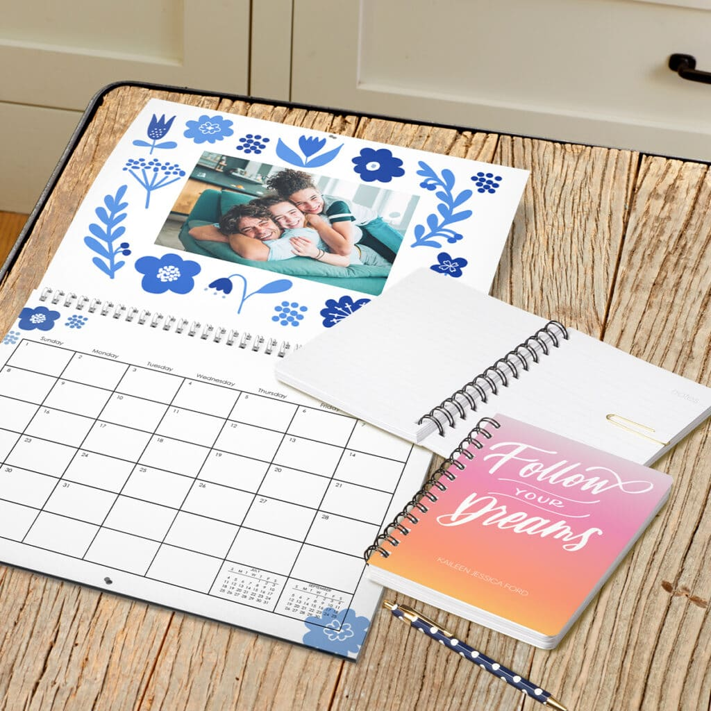 Image showing a custom calendar and notebook laying on a desk