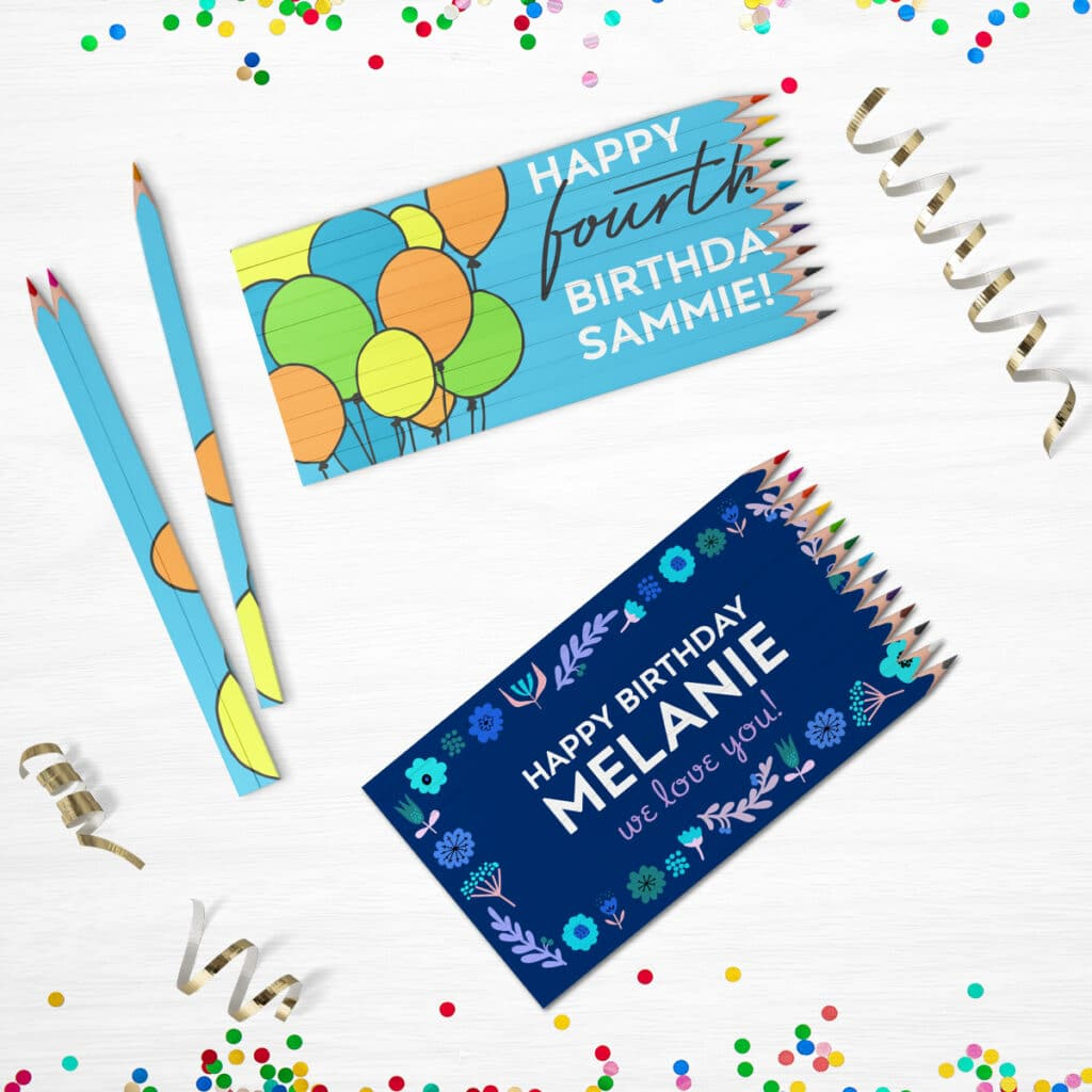 Image of two personalized colored pencil sets featuring birthday designs with confetti and party streamers next to them.