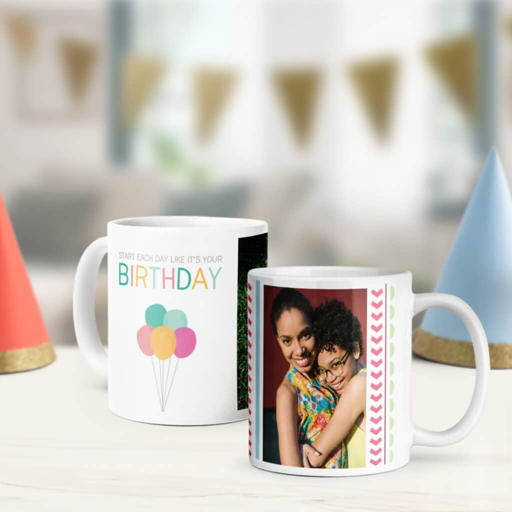 Image of two personalized photo mugs featuring birthday designs. Next to them are a pair of party hats.